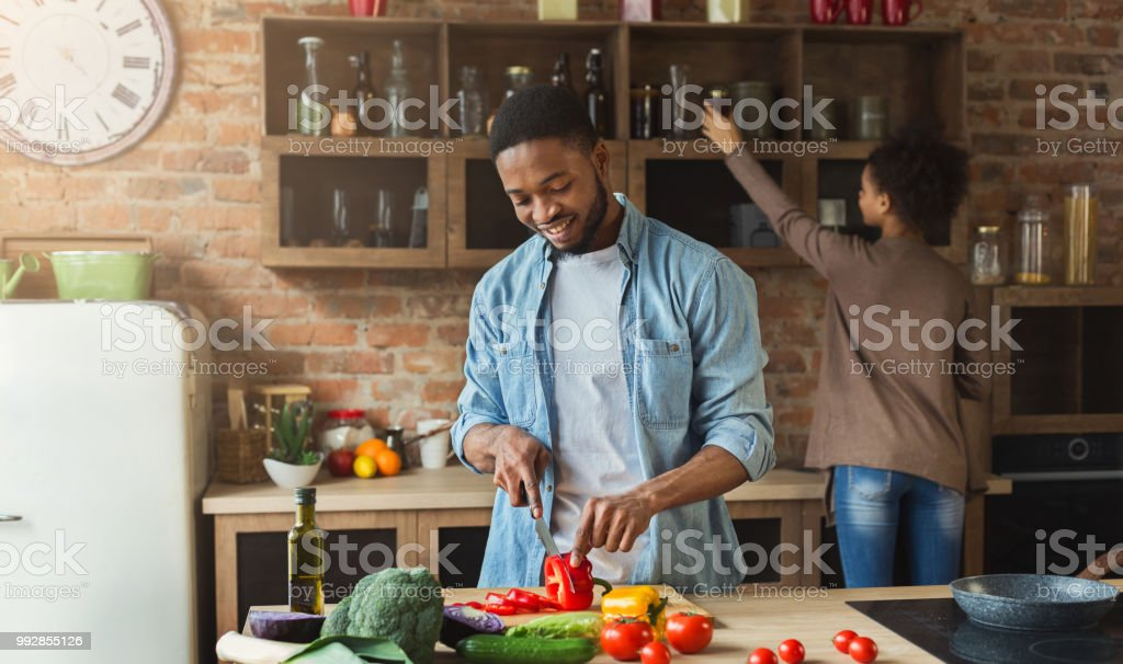 African-american family cooking in loft kitchen stock photo
