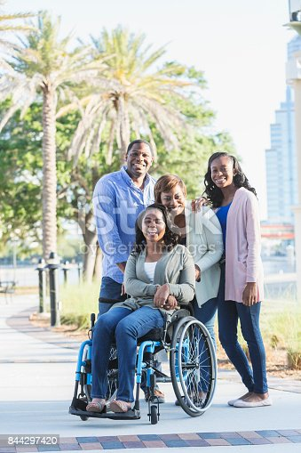 istock African-American family, daughter in wheelchair 844297420