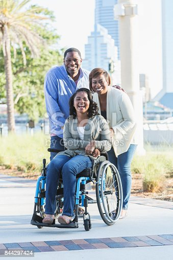istock African-American family, daughter in wheelchair 844297424