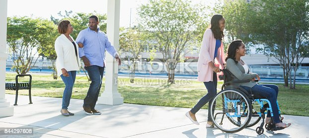 istock African-American family, daughter in wheelchair 844297608