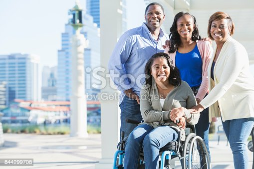 istock African-American family, daughter in wheelchair 844299708