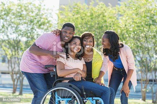 istock African-American family, daughter in wheelchair 844299860