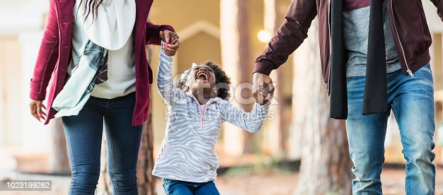 istock African-American family, girl outdoors in fall laughing 1023199262