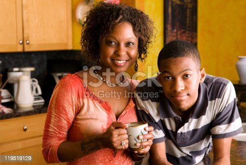 istock African-American family members in kitchen 119519129