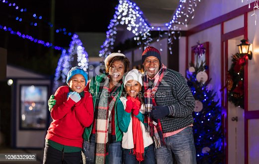 istock African-American family outdoors at Christmas 1036332932