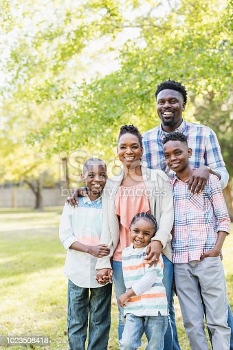 1091098026istockphoto African-American family, three boys posing for camera 1023508418