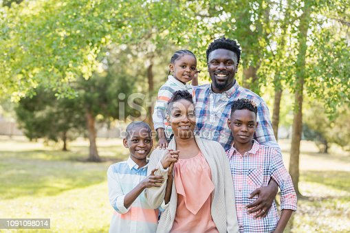 1091098026istockphoto African-American family, three boys posing for camera 1091098014