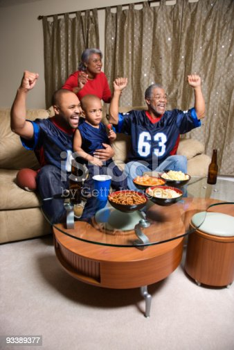 istock African-American family watching sports on tv. 93389377