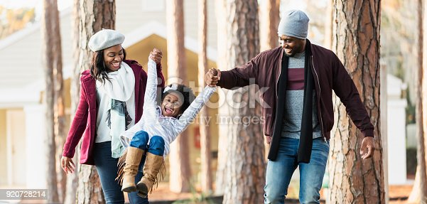 istock African-American family with girl outdoors in autumn 920728214