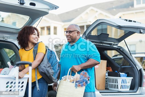 istock African-American father helping daughter move 899704710