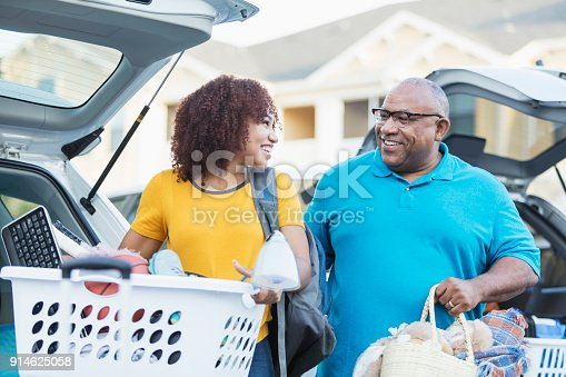 istock African-American father helping daughter move 914625058