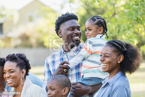 1091098220 istock photo African-American father, little boy with family 1023509054