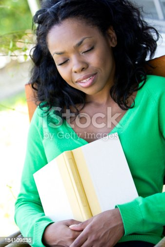 istock African-American female taking a nap on her porch 184109835