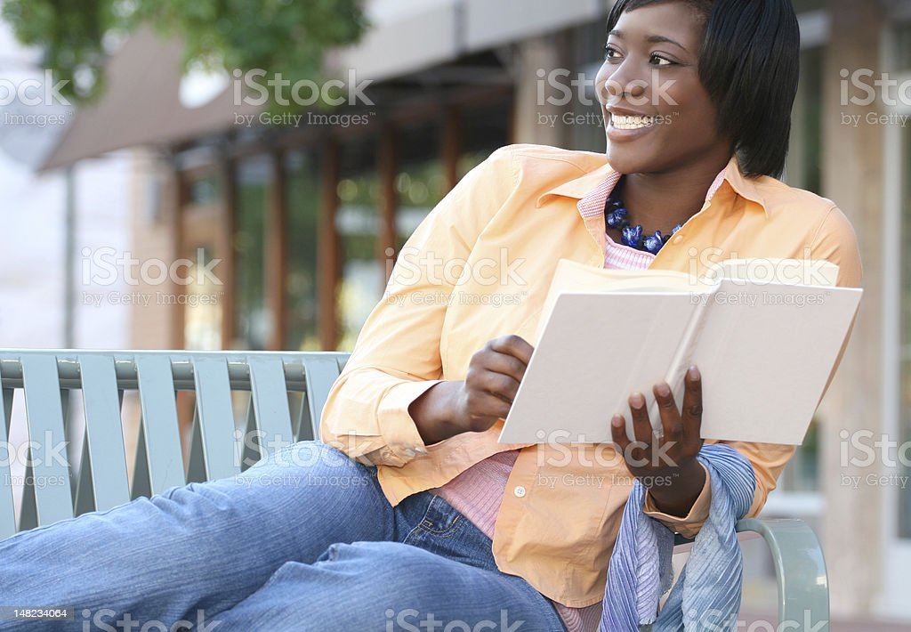 African-American Female , Woman Reading a Book stock photo