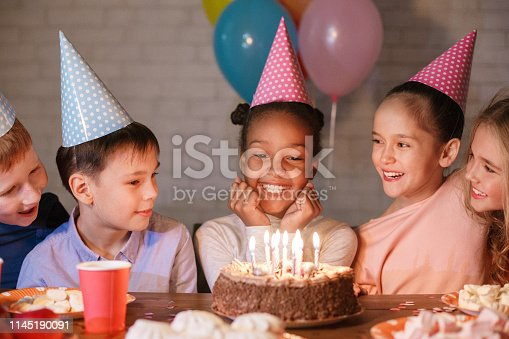 istock African-american girl having birthday party with friends 1145190091
