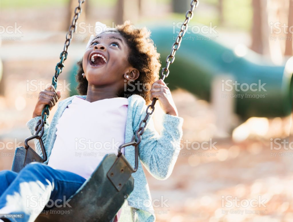 African-American girl on a swing stock photo