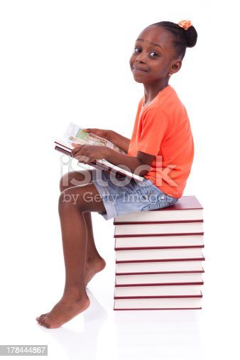 istock African-American girl reading atop stack of books 178444867