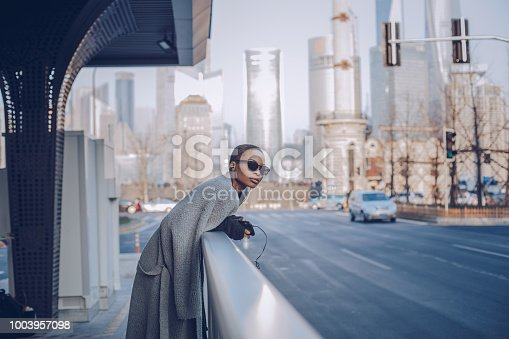 istock african-american lady in big city 1003957098