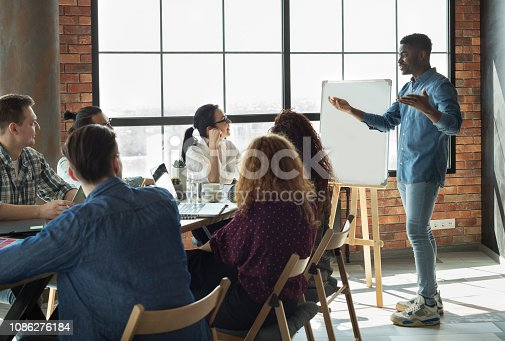 istock African-american leader lecturing his employees in office 1086276184