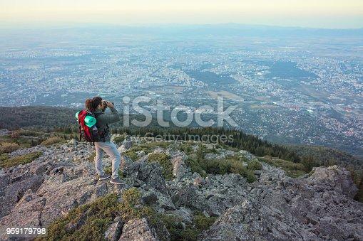 istock African-American male looking through binocular from the mountain peak 959179798