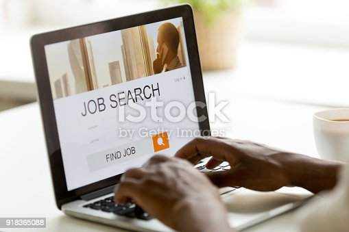 istock African-american man browsing work online using job search computer app 918365088