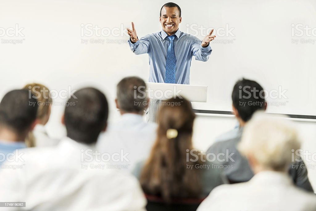 African-American man having a public speech. stock photo