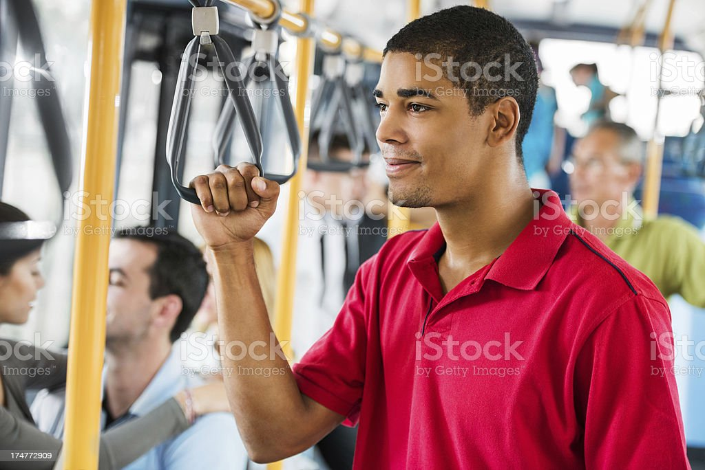African-American man holding a handrail in bus. royalty-free stock photo