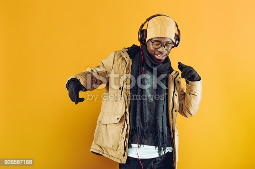 istock African-American man in headphones listening to music 926587168