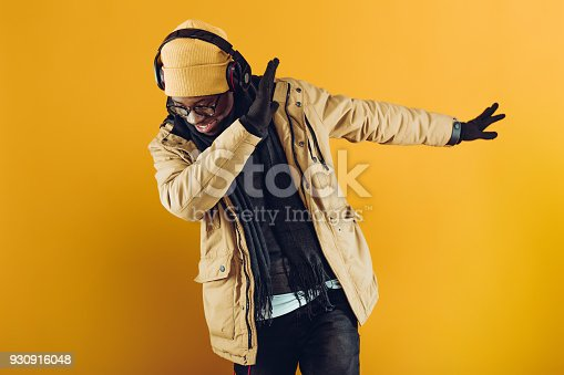 istock African-American man in headphones listening to music 930916048
