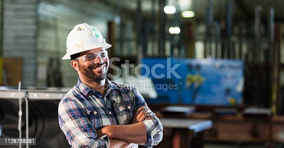 istock African-American man in metal fabrication plant 1128758381