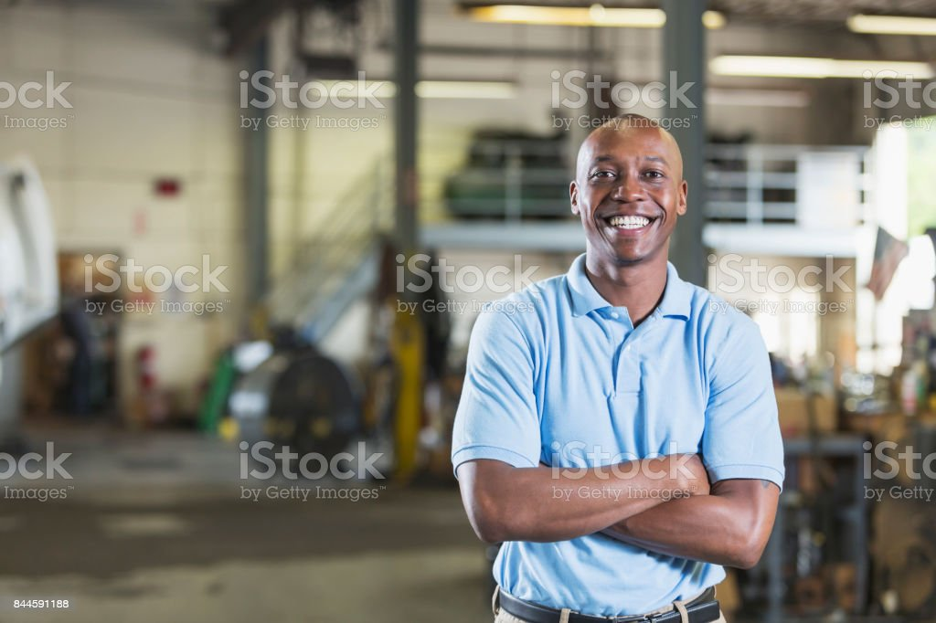 African-American man in vehicle repair shop stock photo