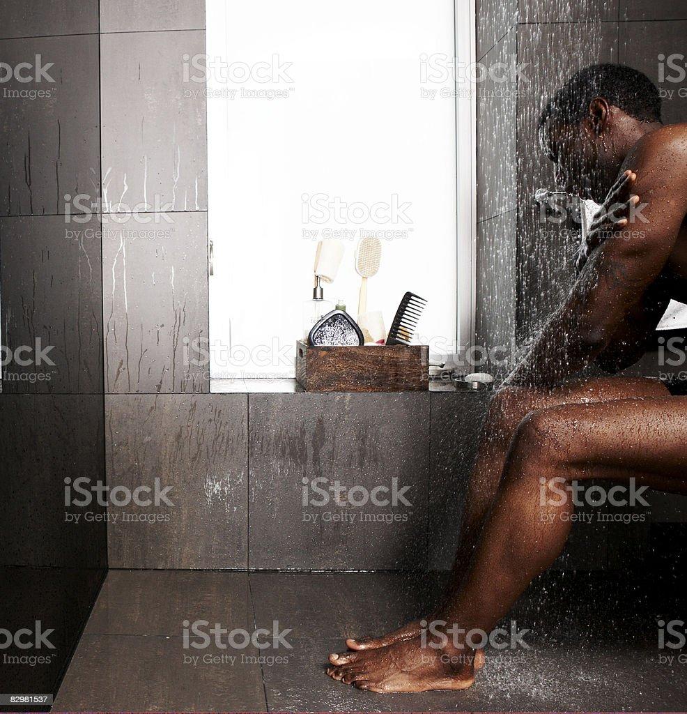 African-American man showering royalty free stockfoto