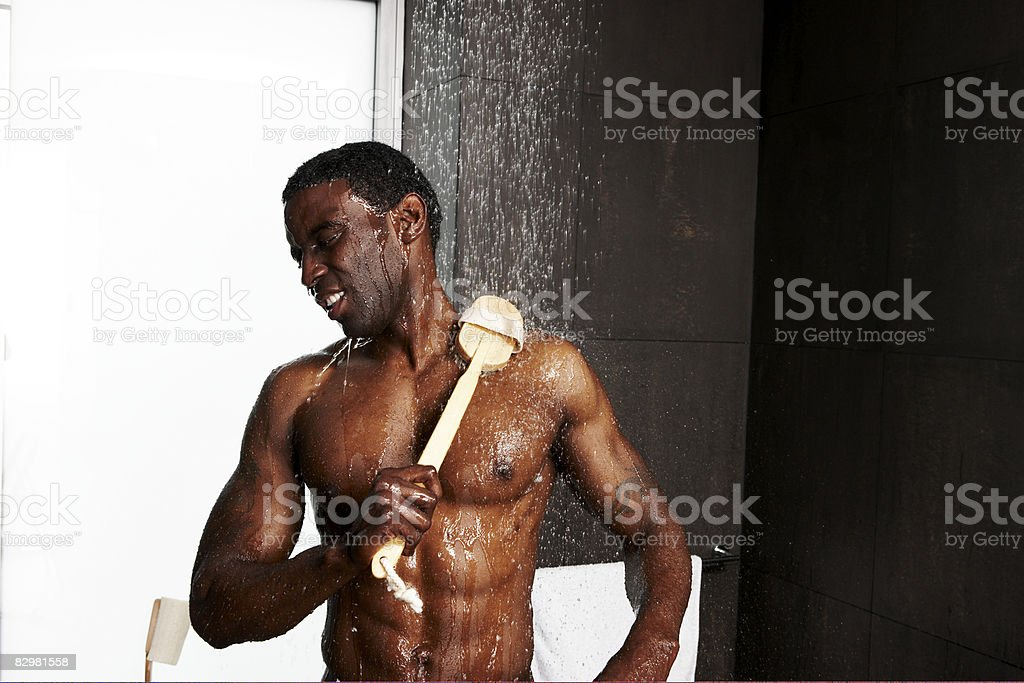 African-American man showering - Royalty-free 30-34 Years Stock Photo