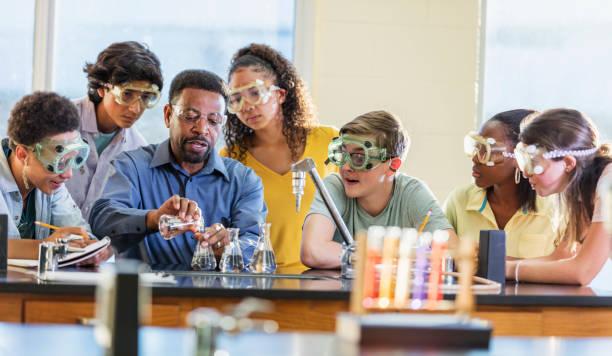 African-American man teaching high school chemistry lab stock photo