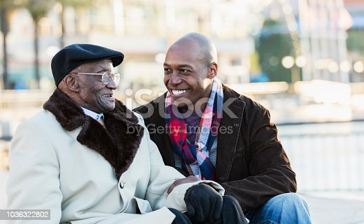 istock African-American man with grandfather In city 1036322802