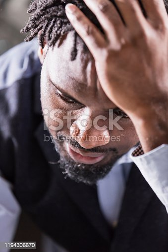 611876426 istock photo African-American man with short dreadlocks 1194306670