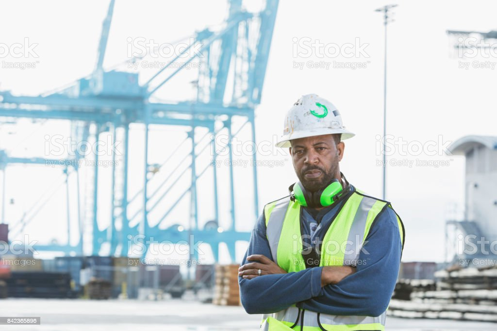 African-American man working at a shipping port stock photo