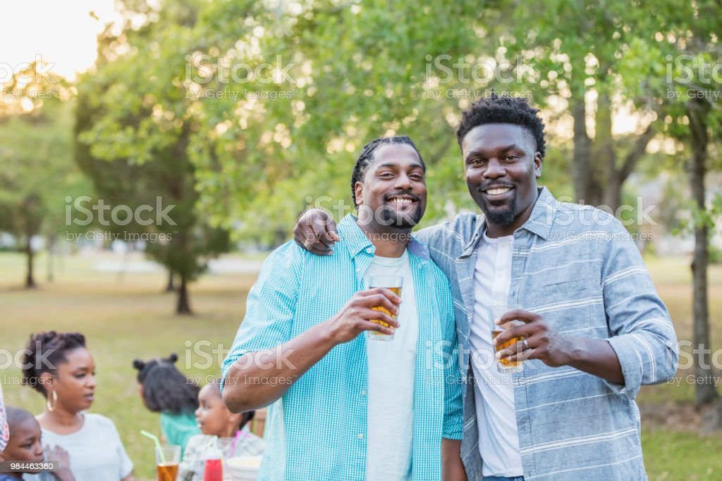 African-American men with family at cookout stock photo