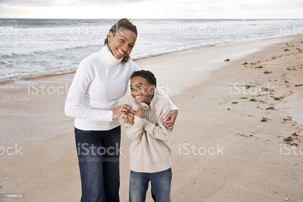 African-American mother and son at beach royalty-free stock photo