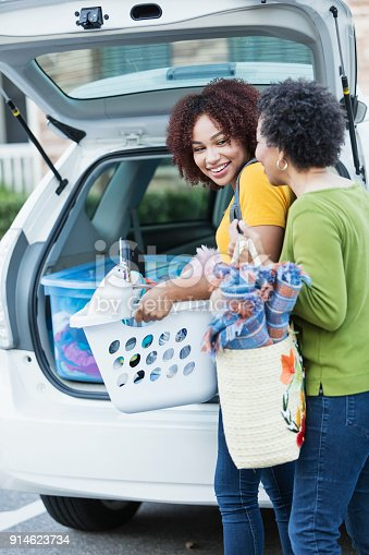 istock African-American mother helping daughter move 914623734