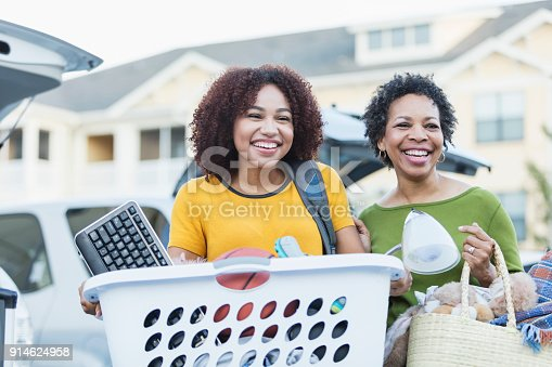 istock African-American mother helping daughter move 914624958