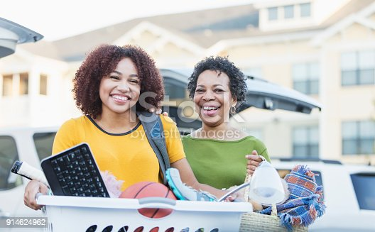 istock African-American mother helping daughter move 914624962