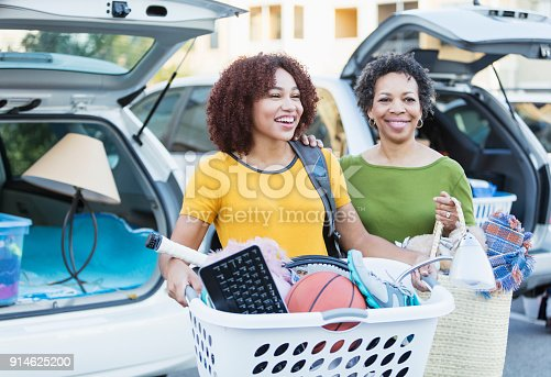 istock African-American mother helping daughter move 914625200