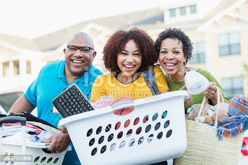 istock African-American parents helping daughter move 899704966