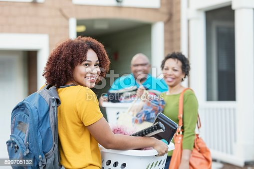 istock African-American parents helping daughter move 899705132