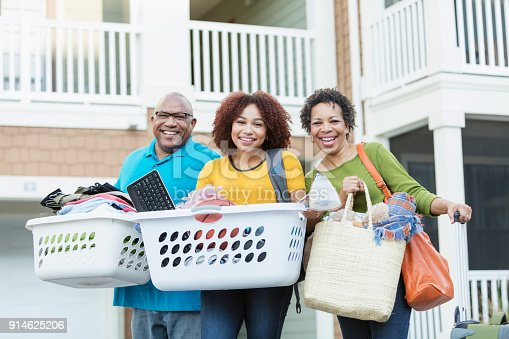 istock African-American parents helping daughter move 914625206