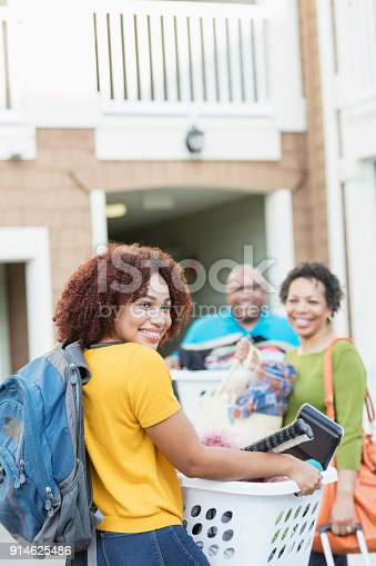 istock African-American parents helping daughter move 914625486