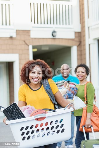 istock African-American parents helping daughter move 914625530