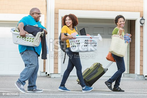 istock African-American parents helping daughter move 914625540