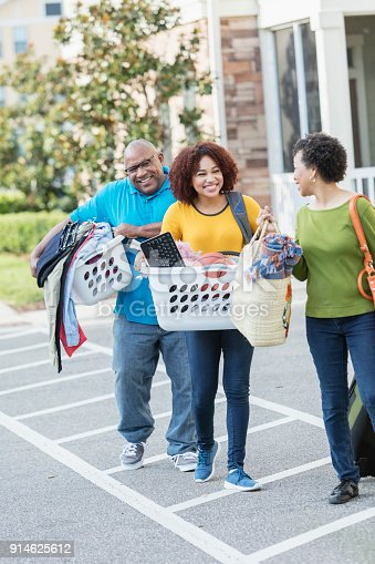 istock African-American parents helping daughter move 914625612